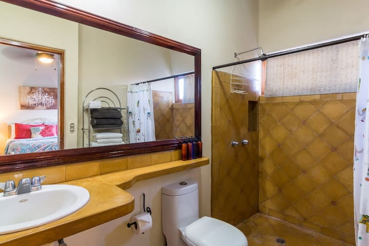 Upstairs master bathroom is connected to master bedroom. Please note that hot water is at each tap, directly from pipes (no electric showerhead attachment). Hairdryers, towels, basic toiletries and robes are provided.