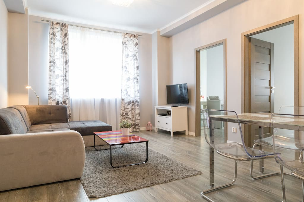 Relax in the spacious living room with a table, folding sofa bed and a TV