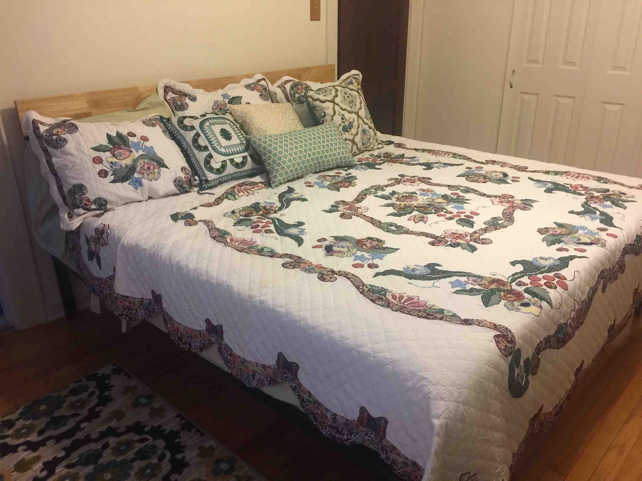 Plenty of room to relax in your king size bed, loaded with fluffy pillows and warm layers of blankets topped off with a homey quilt.