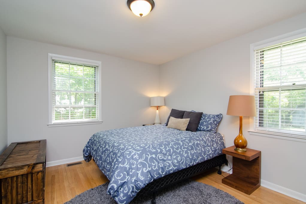 """Master bedroom has a queen size bed and an en-suite half bathroom // """"The house was perfect. Easy Lyft ride home at night and into town. The beds were comfortable and everything went off without a hitch. I would definitely stay again."""" -Brandon ★★★★★"""
