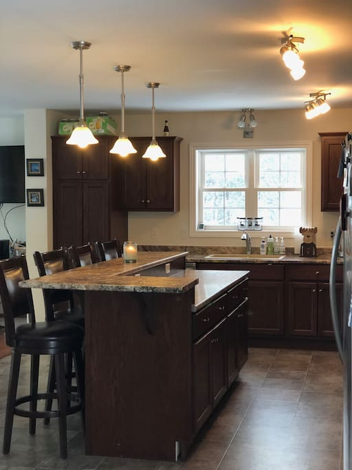 HUGE kitchen - open concept; features large island with bar seating for 4