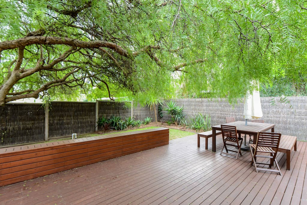 Huge outdoor decking, shaded by the glorious peppercorn tree