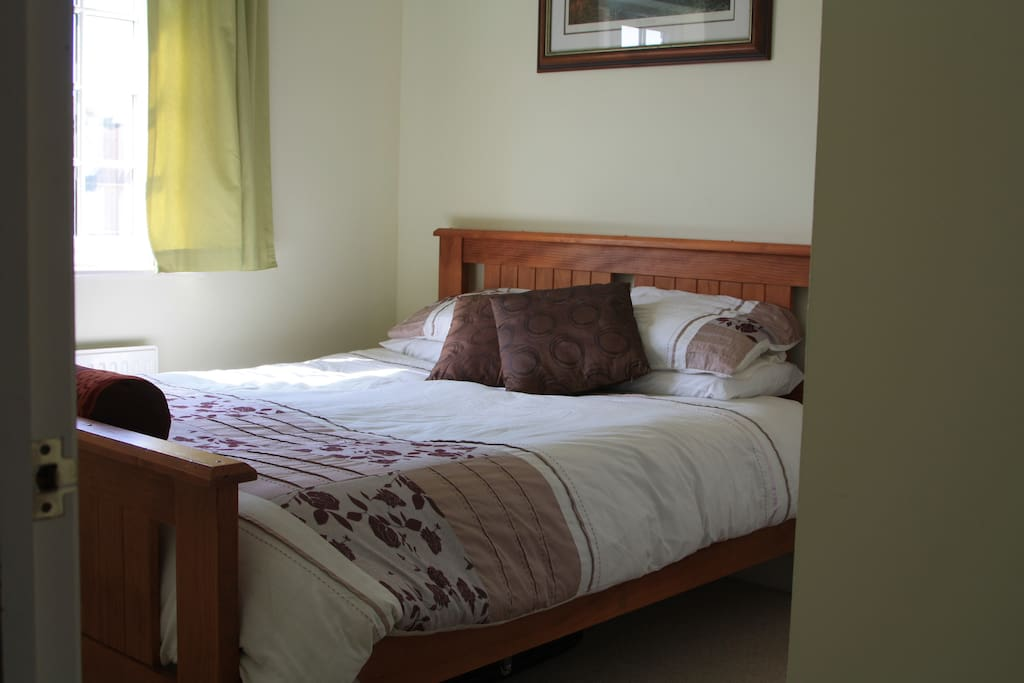Grab a good night's sleep in the  comfortable queen size bed