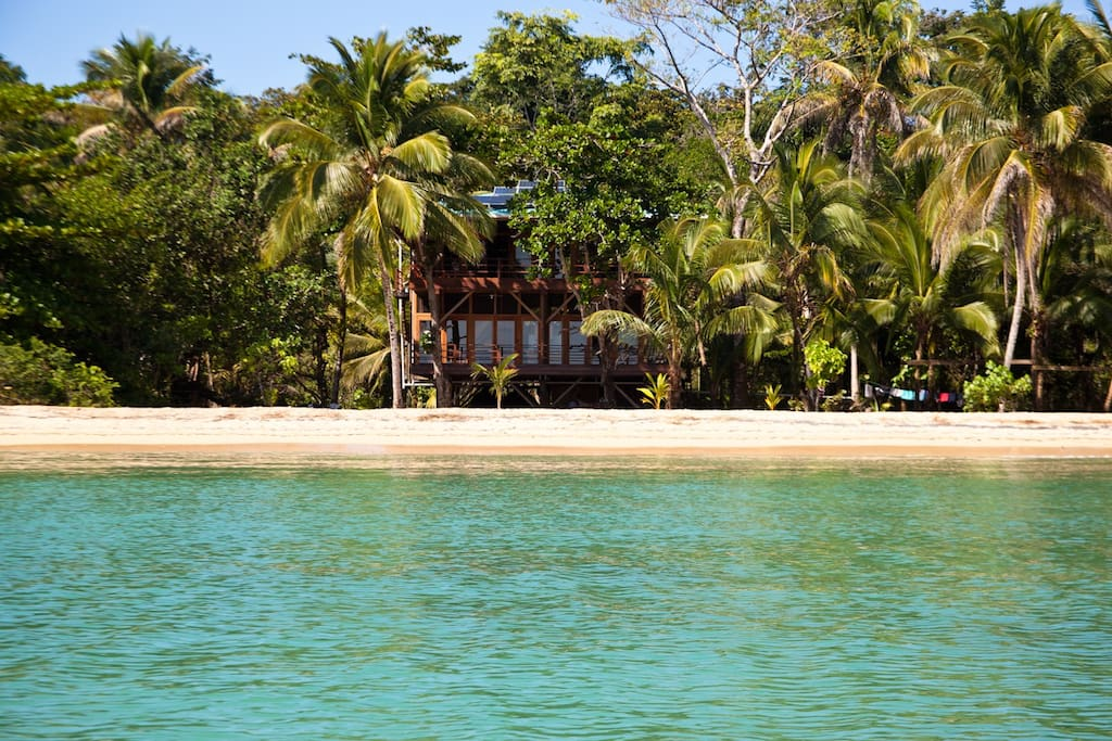 the beach front villa and the water of the lagoon