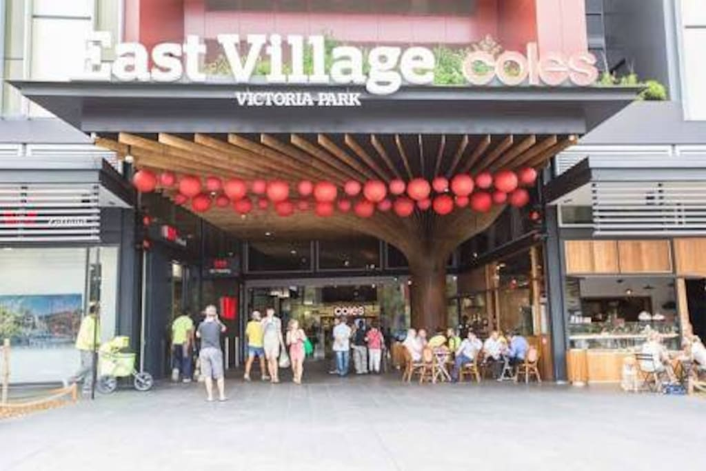Near East Village shopping centre with supermarket and cafes