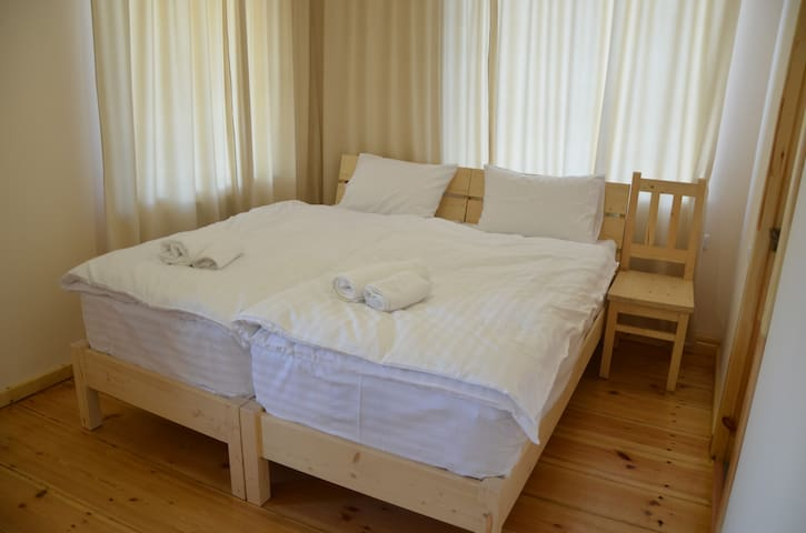"""Double bed in the """"Autumn"""" room"""