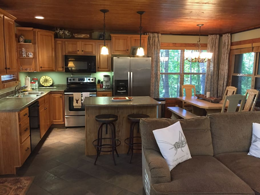 Welcome to our spacious and fun kitchen and entertaining area. Entertaining area has loft area overhead, gas logs, TV with satellite. Plenty of room for lounging on sofas.
