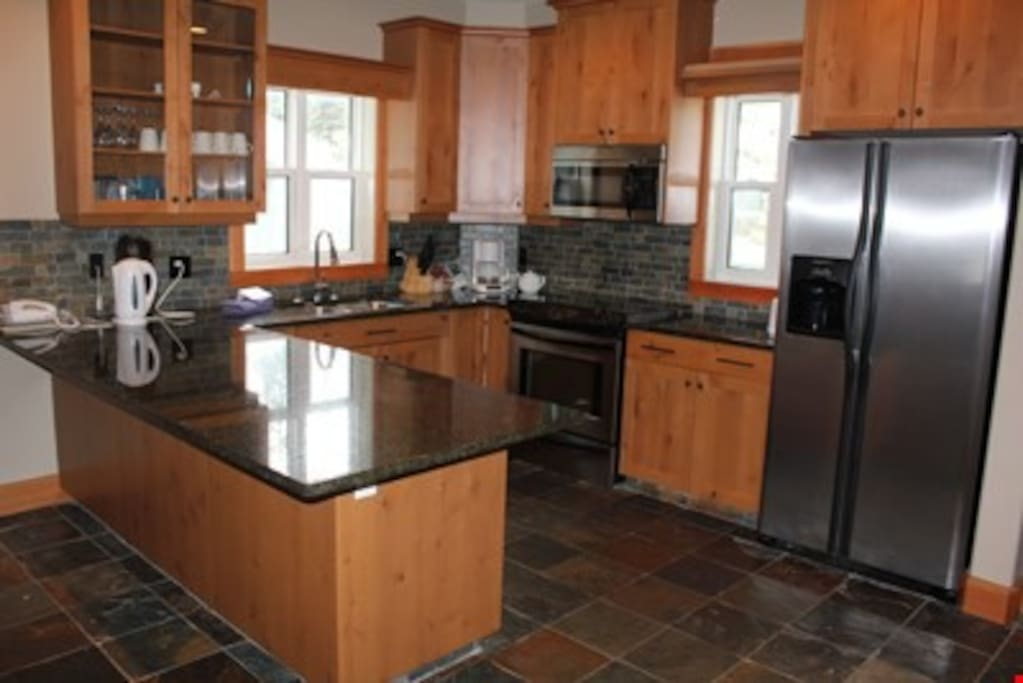 Cook meals in the fully-equipped kitchen, complete with up to date appliances.