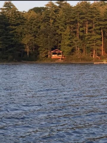 Nestled Gazebo where guests can entertain and relax after a day on the lake. Full patio set, table and lounge chair. Accessible at night as well, with detailed lighting that disperses through the forest,lake and fire pit. Star gazing optional.