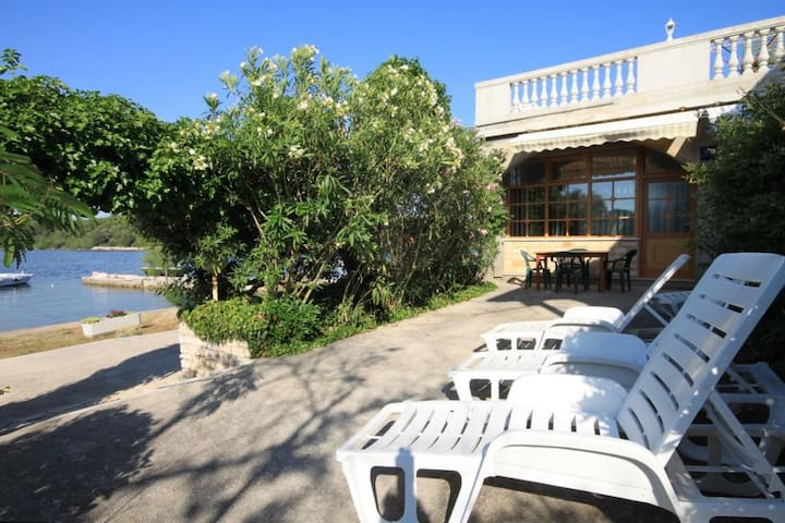 Two bedroom apartment near beach Veli Rat (Dugi otok) (A-438-a)