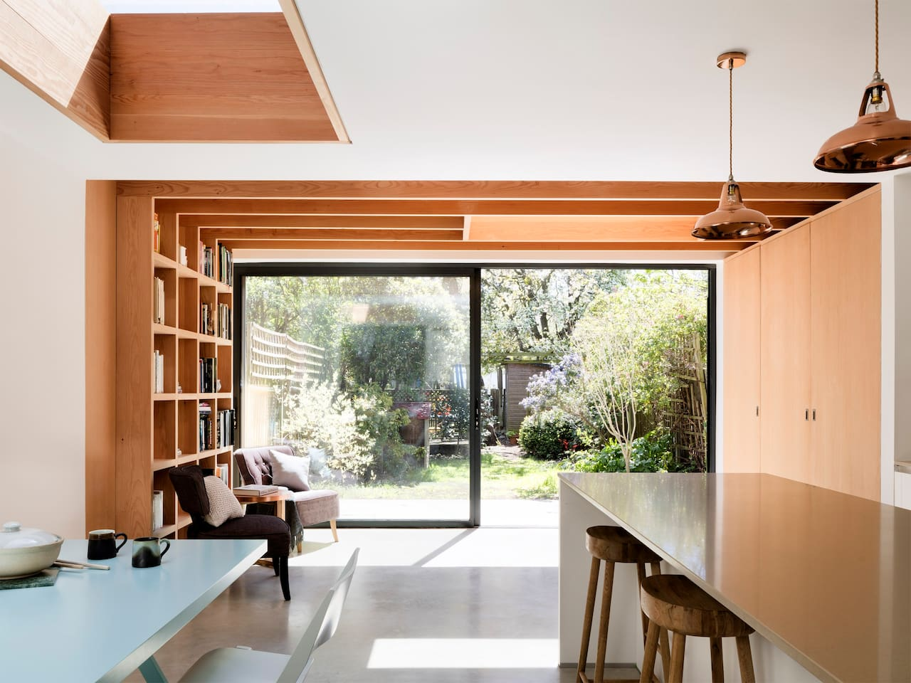 Kitchen with massive sliding doors onto garden