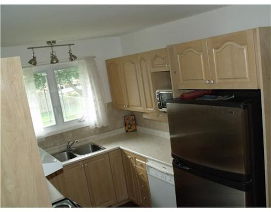 Good working Kitchen with double window overlooking huge backyard.