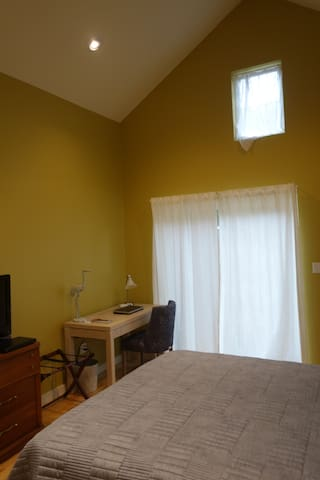 Fully furnished bedroom with high ceilings!