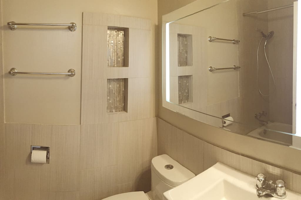 Newly renovated bathroom with massage shower.