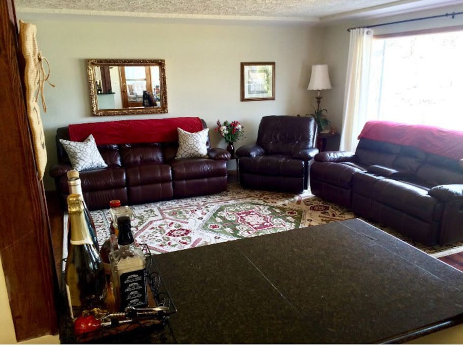 Cosy Living Room, leather furniture, 5 recliners, 50 inch TV and DVD player!