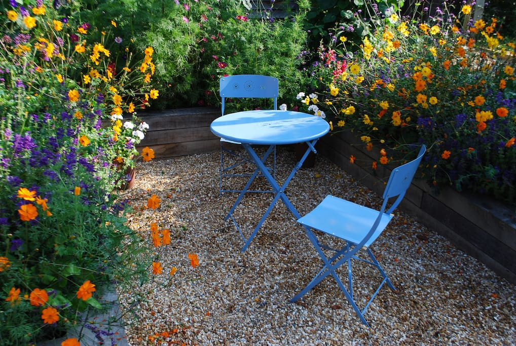 Sit amongst the flowers in the sunny courtyard