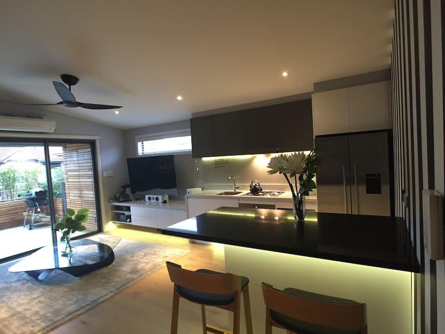 Open plan kitchen/breakfast bar/lounge which flows out onto the terrace with full bbq