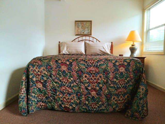 Queen bedroom with adjoining bath