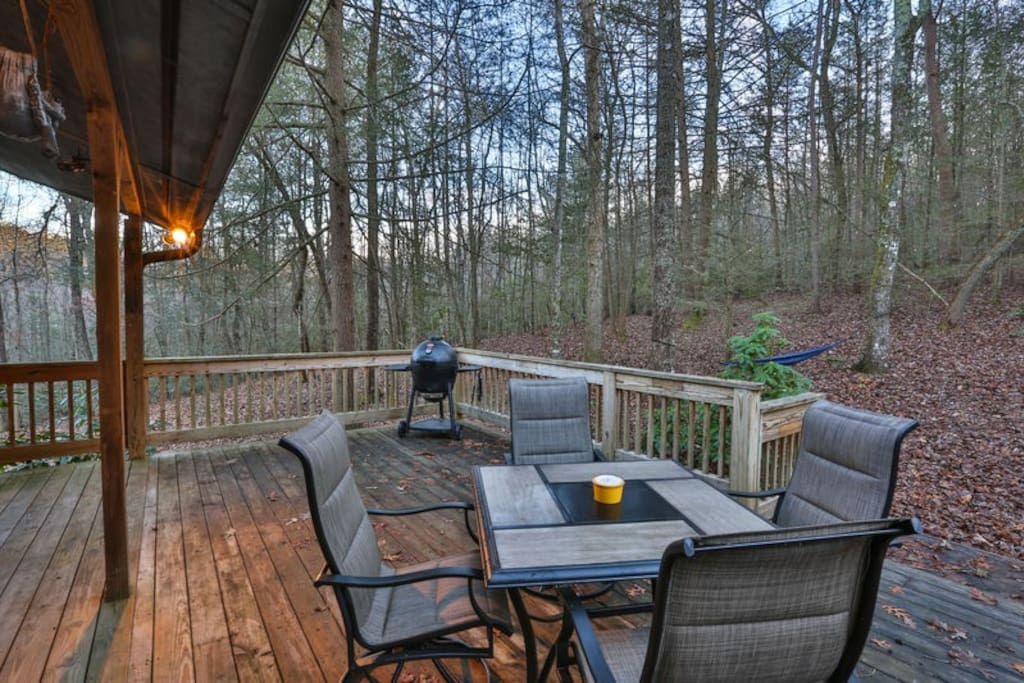 Deck with grill and comfy seating.