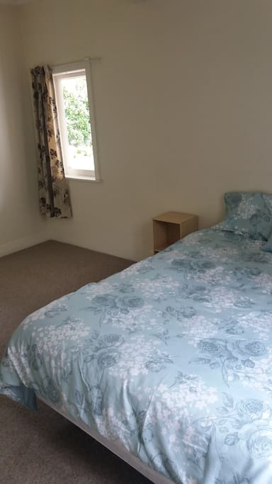 There is a small bedroom with Rimu bunks off this main bedroom