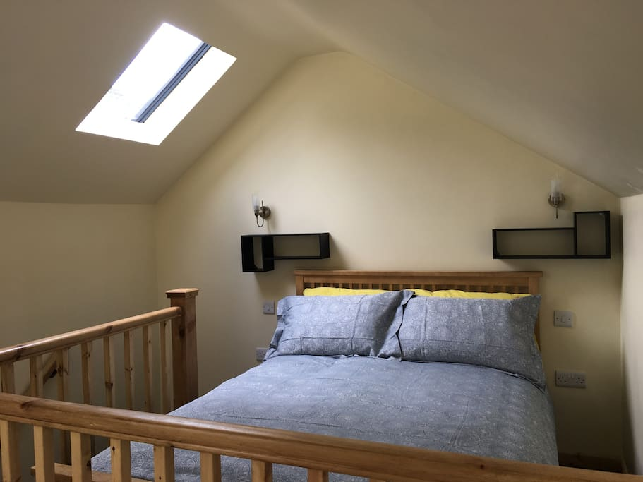 The double bed on the sleeping platform