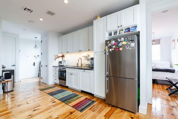 New appliances and natural oak hardwood laminated floors
