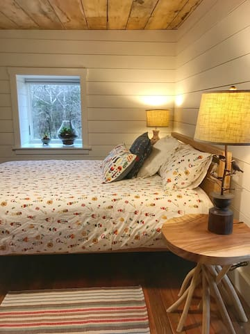 """The """"Nature"""" bedroom, fresh and comfy linens and beds"""