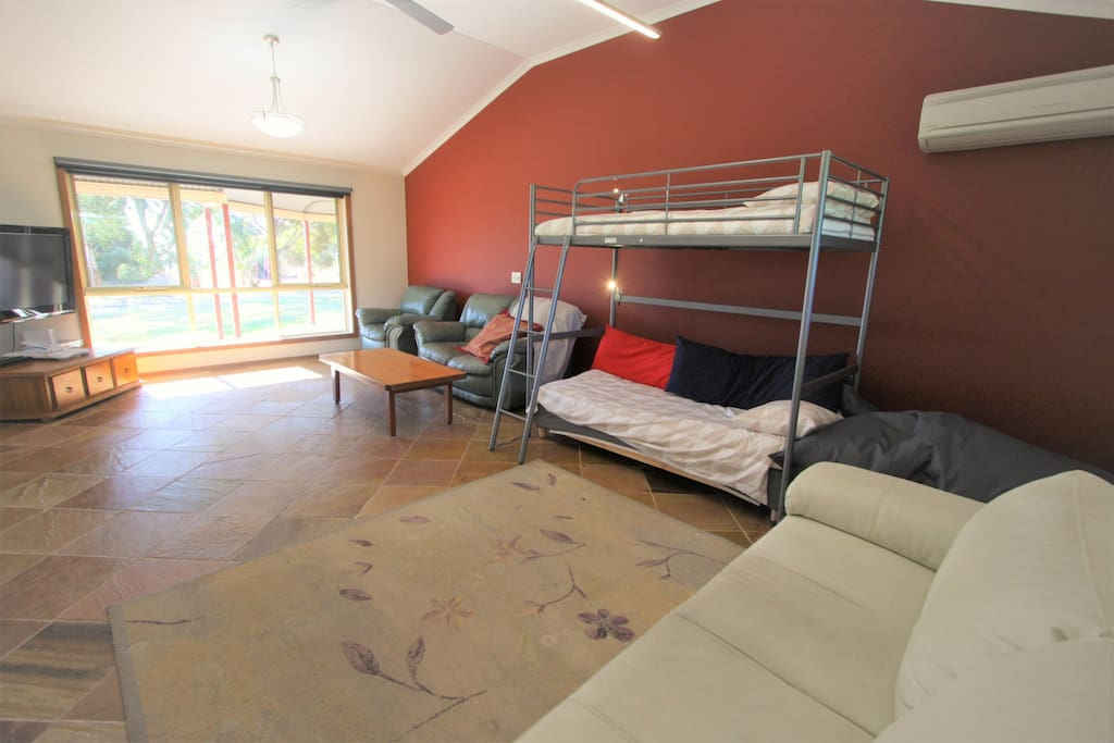 Extra large Living Room with kid-size bunk bed & double sofa bed