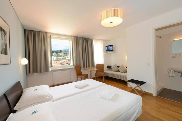 Classic triple bed room near Lake Lugano & Casino