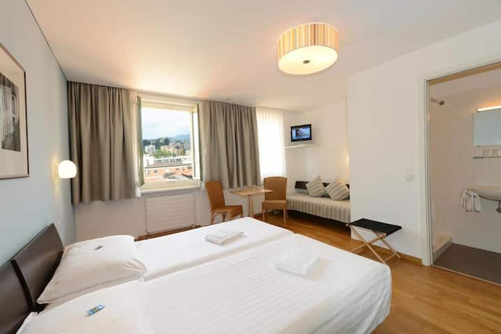 Classic triple bed room near Lake Lugano & Casino
