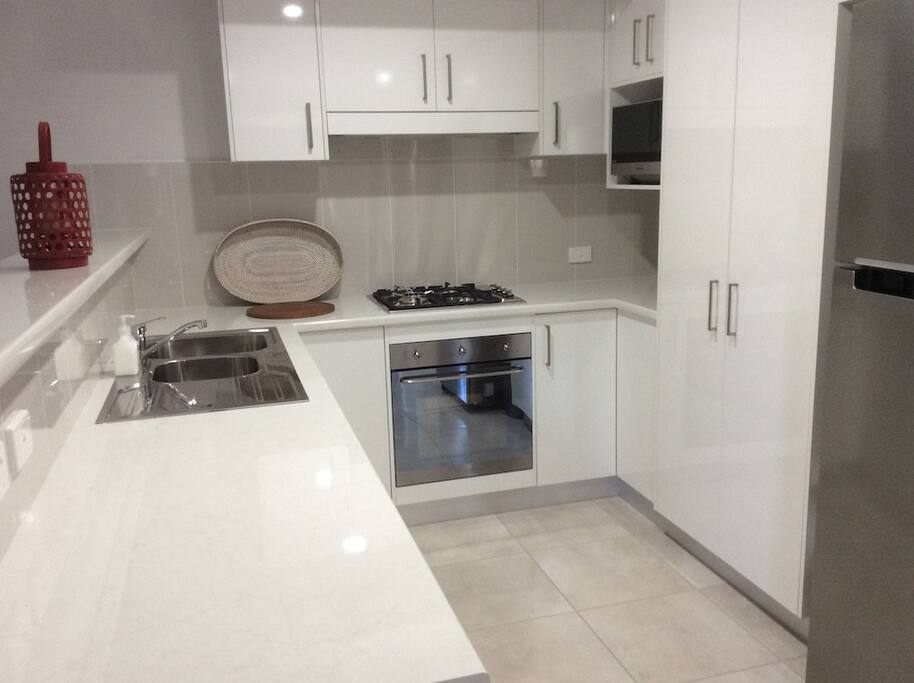 Fully finctionalkitchen with dishwasher, microwave, full size fridge/freezer, gas cooking with electric oven.