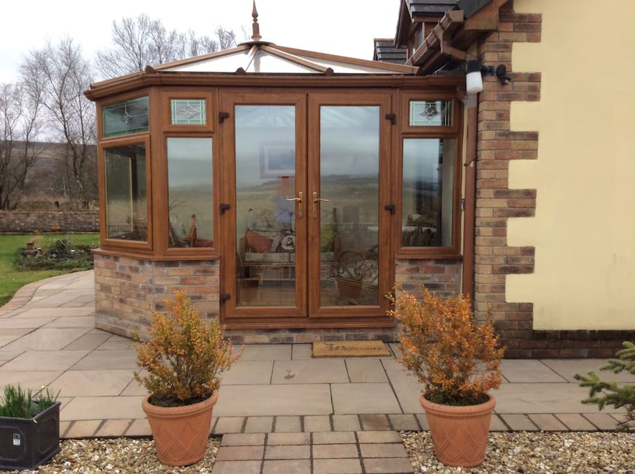 The conservatory from which you can relax and see the stunning Brecon Beacons