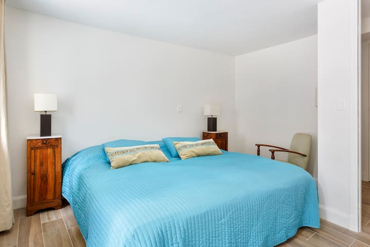Double bedroom - King size bed (1,8mx2m), wardrobe and chest of drawers, doors onto terrace.