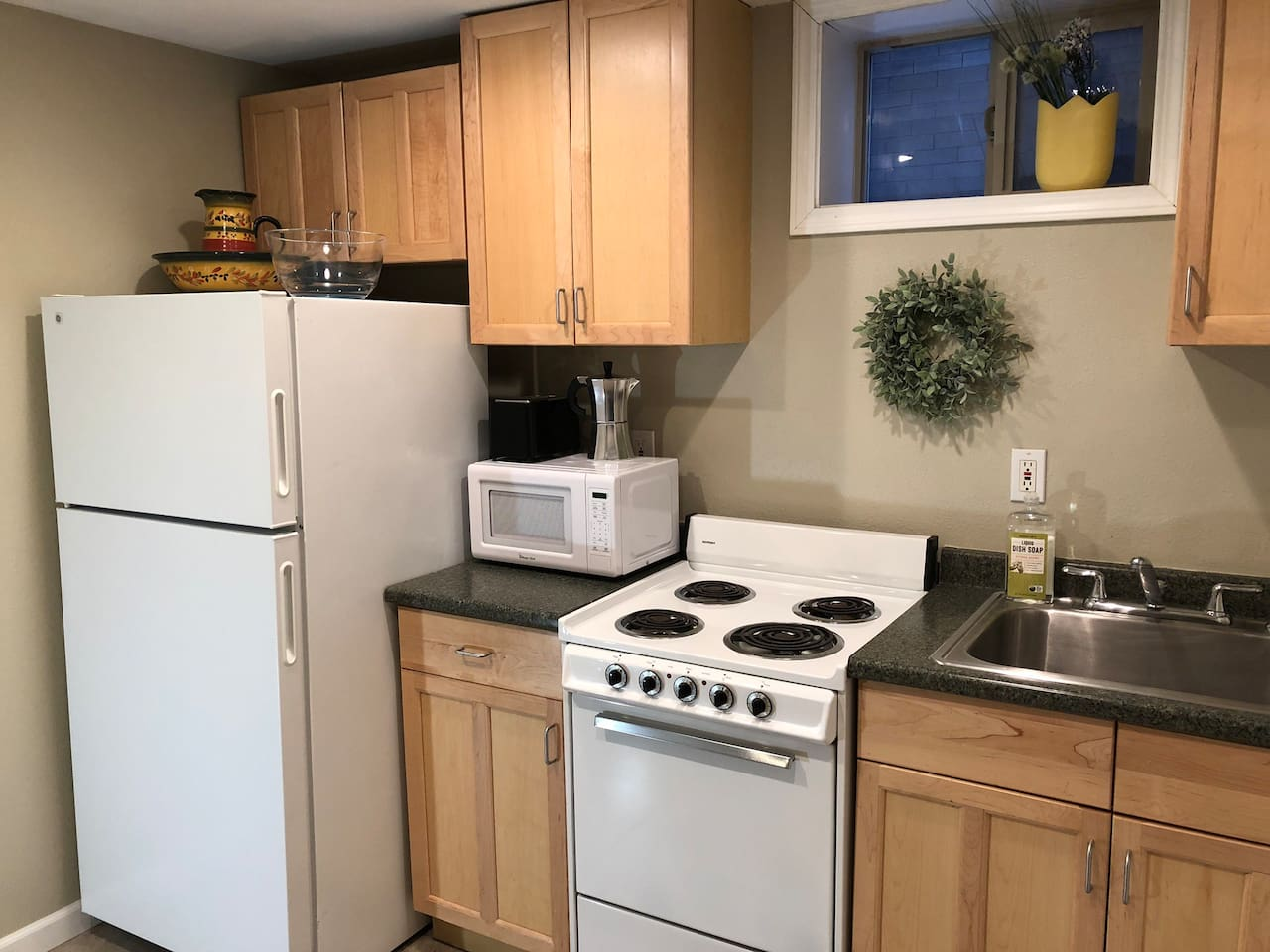 Fully stocked kitchen to meet your cooking needs. Coffee maker, microwave, and toaster oven.