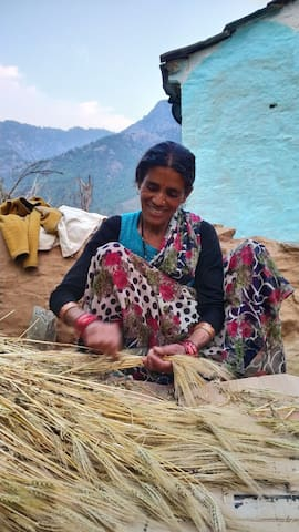 A beautiful village lady working on her family produce.