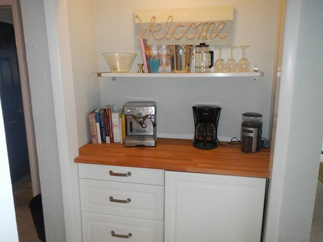 Under counter beverage fridge, gourmet coffee and tea.