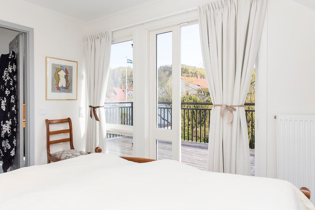 Sunny master bedroom with balcony overlooking the garden.