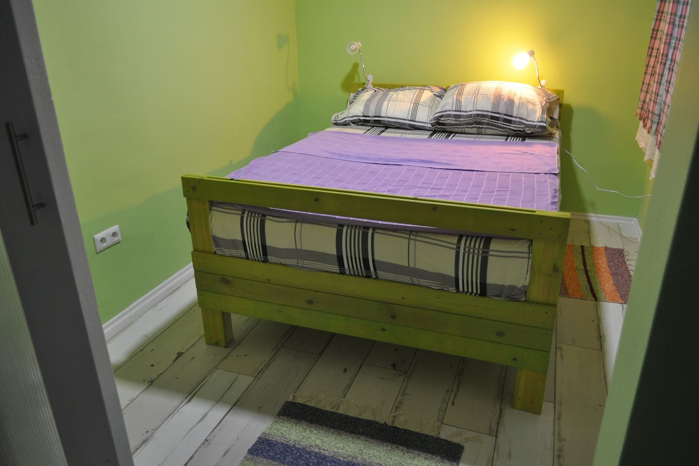 Double sized bed in bedroom with sliding doors.