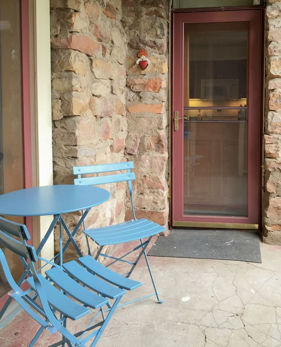 Enjoy your own covered outdoor seating at the apartment's entrance