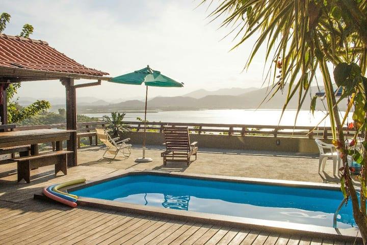 Suite em condomínio e incrível vista para lagoa