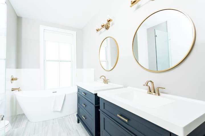 Super hip newly renovated bathrooms. The master has a freestanding tub to soak in after a long day on the town and a frameless shower.