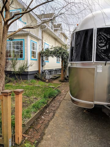 Take the path up the driveway, past the airstream, between the main house and the cottage and find your entrance through the blue side door to the cottage.