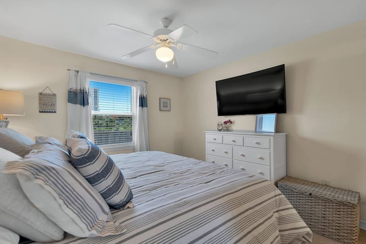 """Master Bed with 55"""" Smart TV"""