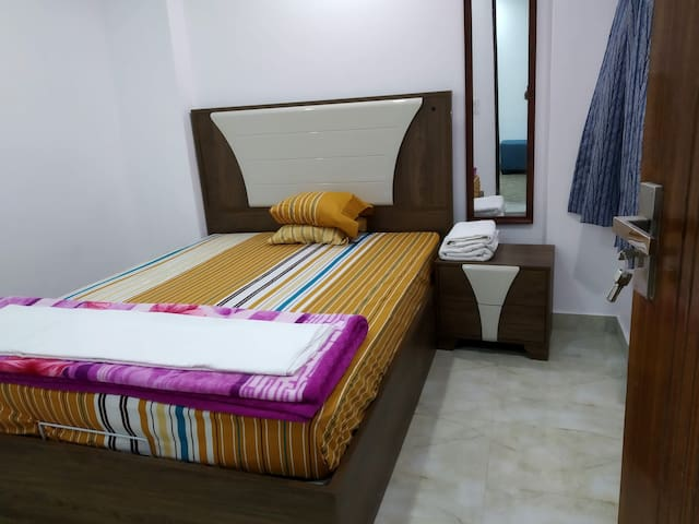 The bed room with air conditioning, heating, blankets and wardrobes