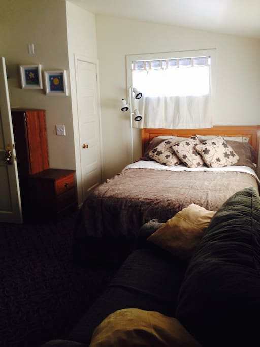 Comfy queen bed and storage area