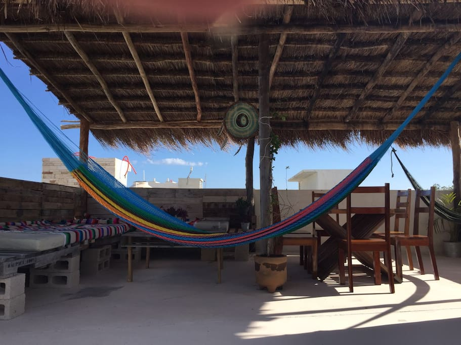 Nice terrace with a chill area dinning room and 2 hammocks with nice view and plant of the region