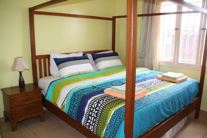 king size bed , window to allow natural light