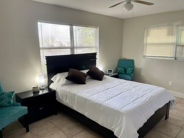 Master bedroom with a queen size bed and an attach restroom