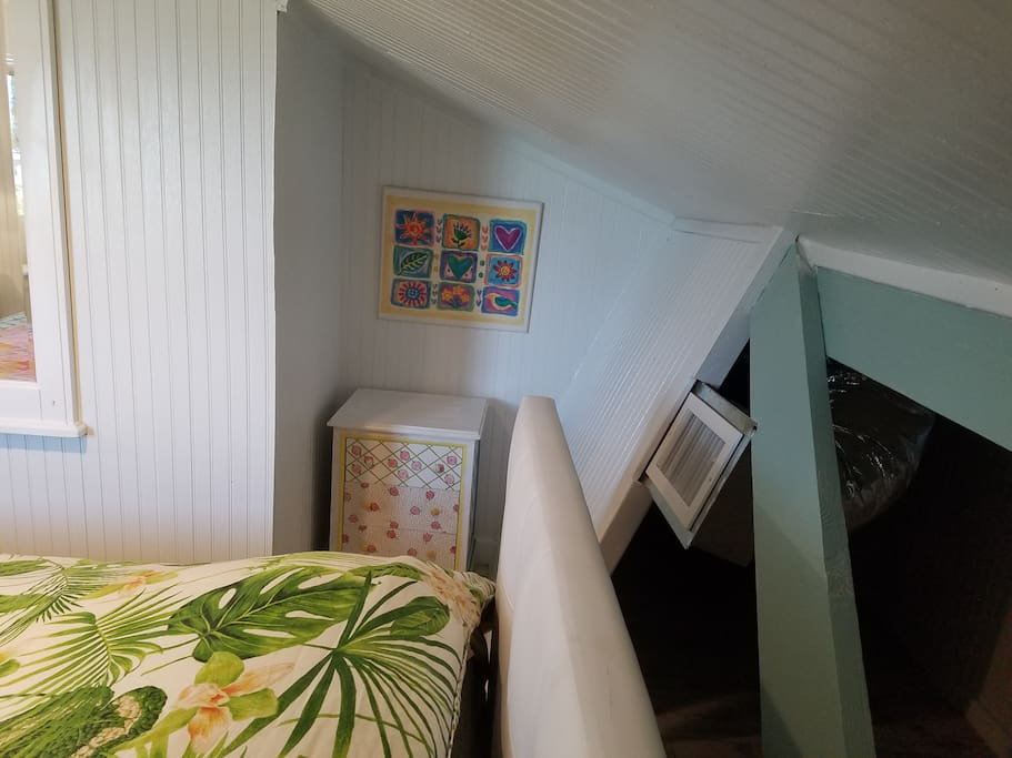 Loft bed cubby area and small dresser