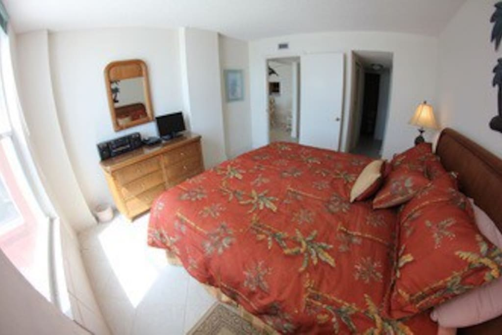 Master bedroom with ample closet and bathroom. Wake up every morning and Look at your window to see the pristine Gulf of Mexico!